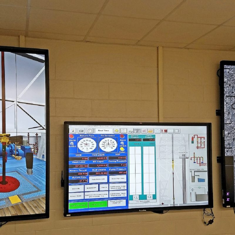 DrillSIM:Educator interactive drilling controls and graphic views of downhole and surface equipment on three screens